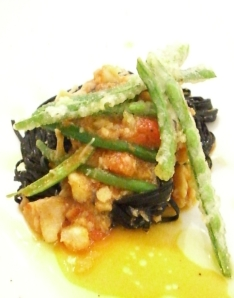 Squid ink tagliolini with monkfish cheeks and crispy greenbeans